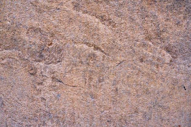 Tekstura ściany z rzadkiego rocznika granitu. naturalne tło.