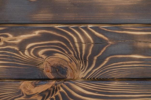 Tekstura spalonego brązowego ciemnego drewna