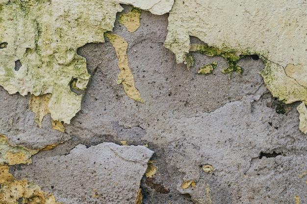 Tekstura stara betonowa ściana z krakingowym farby tłem