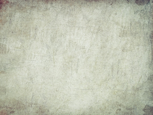 Tekstura starego arkusza papieru z zadrapaniami i plamami