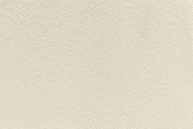 Tekstura starego jasnobeżowego papieru tle gęstego kartonu piasku