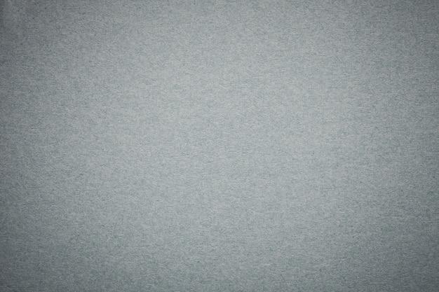 Tekstura starego szarego tła papieru, struktura gęsty jasny srebrny karton.
