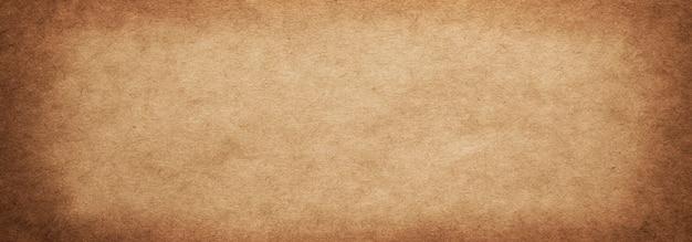 Tekstura starego szorstkiego brązowego papieru z winietą