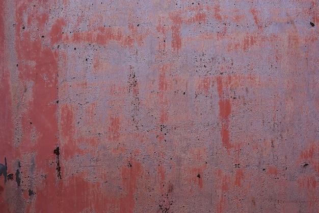 Tekstura starego zardzewiałego arkusza żelaza z łuszczącą się farbą