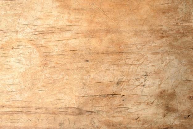 Tekstura starej brązowej drewnianej deski do krojenia, pełna klatka, tło dla projektanta, z bliska