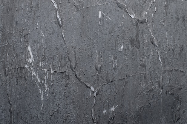Tekstura starej ściany w ciemnym odcieniu koloru