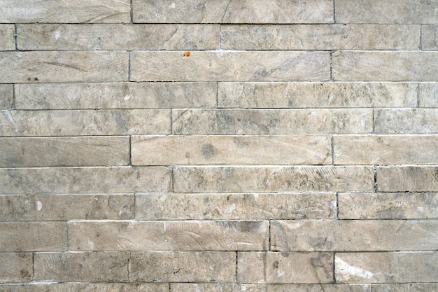 Tekstura starej ściany wykonanej z kamiennych bloków tła