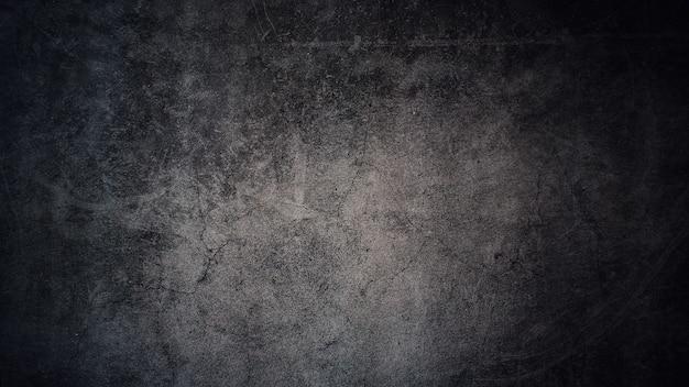 Tekstura starej szarej betonowej ściany na ciemnoszarym tle