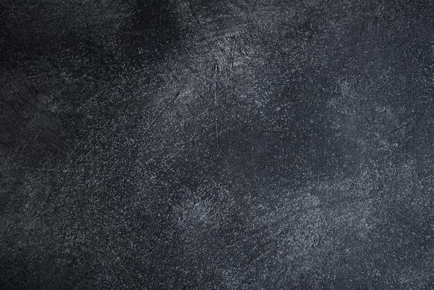 Tekstura starej szarej betonowej ściany na powierzchni