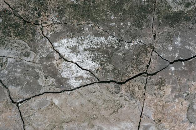 Tekstura stary beton z pęknięcia tłem