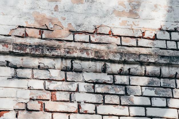 Tekstura stary ściana z cegieł z obieranie tynkiem