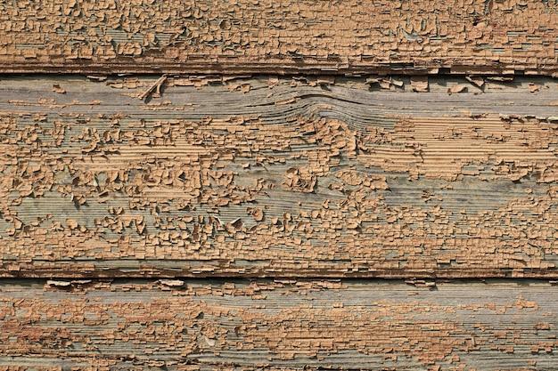 Tekstura starych desek z pozostałościami brązowej farby