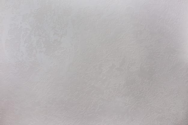 Tekstura szarego kamiennego tynku dekoracyjnego lub ściany betonowej