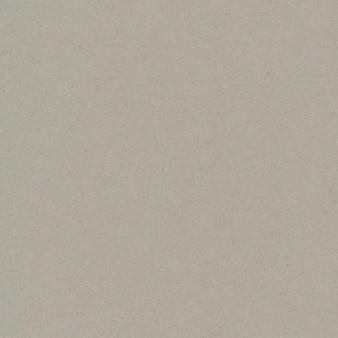 Tekstura szarego papieru z recyklingu z kopią przestrzeni