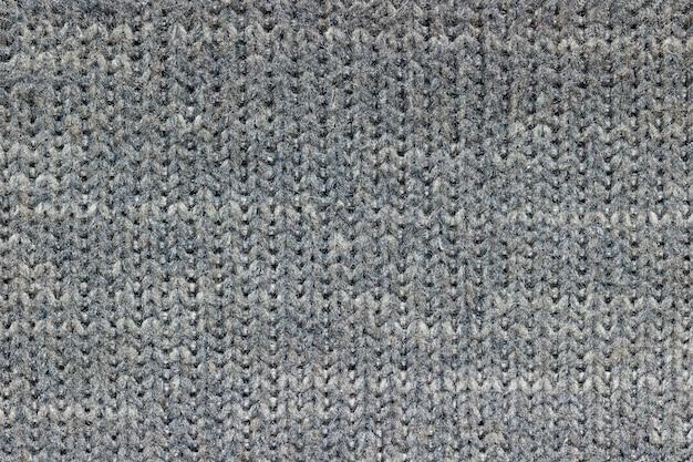 Tekstura szarej kurtki. pojęcie ubrania lub mody.