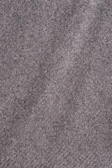 Tekstura szarej wełnianej tkaniny zbliżenie. materiał tła tekstury.