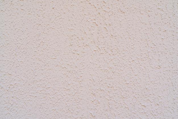 Tekstura szorstkiego białego tynku. architektoniczne streszczenie tło.