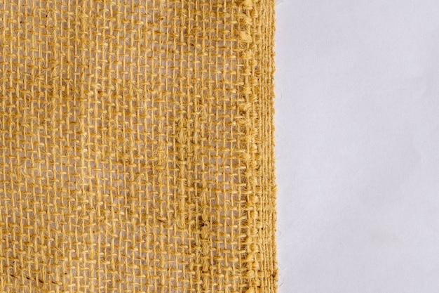 Tekstura tkanina juty na białym tle.