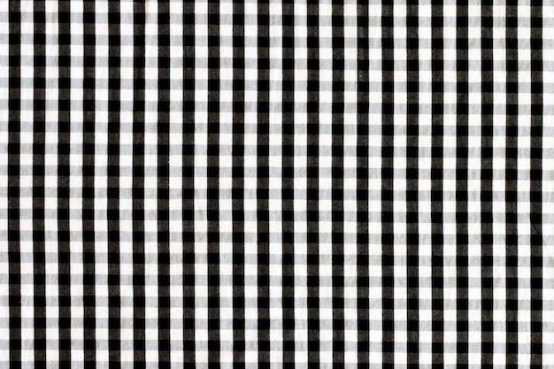Tekstura tkanina w klatce. czarno-biały materiał w kratę.