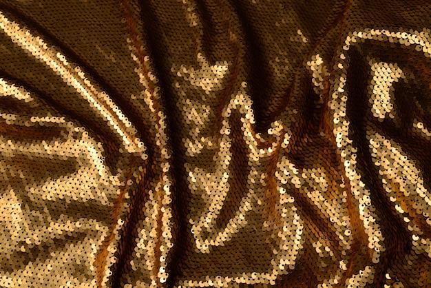 Tekstura tkanina złote cekiny.