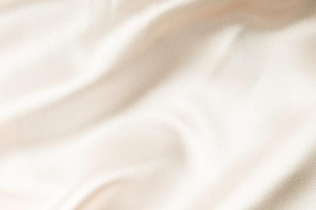 Tekstura tkaniny jedwabnej beżowej