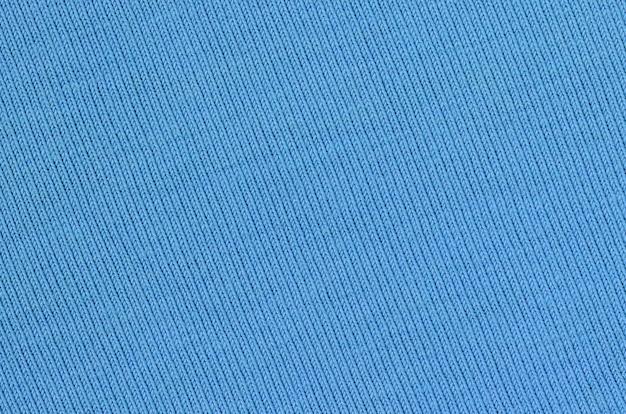 Tekstura tkaniny na niebieskim tle
