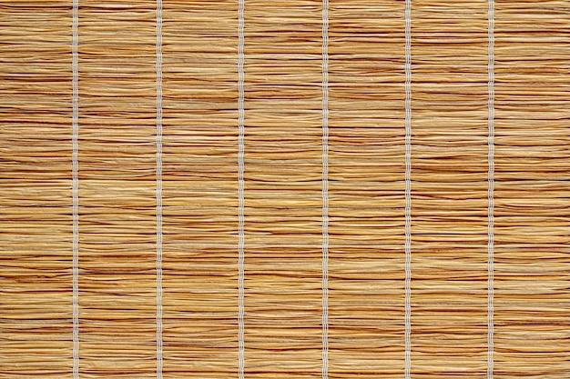 Tekstura tkaniny słomianej ekologicznej podkładki lub obrusu z odnawialnych materiałów organicznych