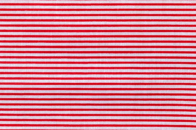 Tekstura tkaniny w czerwone i białe poziome paski. jasne kolorowe tło bawełniane