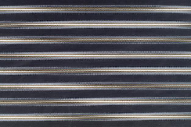 Tekstura tkaniny w kolorze bawełny. fabryka materiału włókienniczego poboru tła z bliska. do szycia na miarę