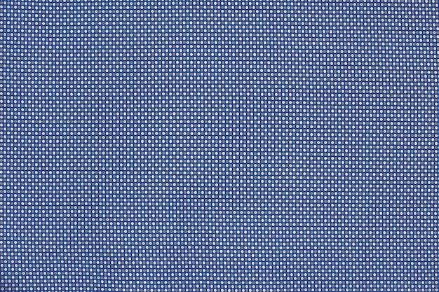 Tekstura tkaniny w kolorze bawełny.