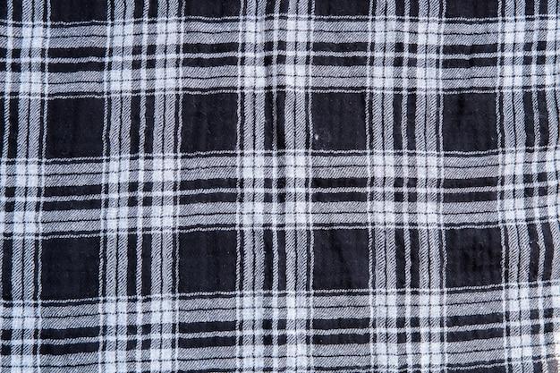 Tekstura tkaniny w kratkę. kwadraty na tkaninie. tło naturalne tkaniny.