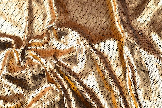 Tekstura tkaniny złote cekiny.
