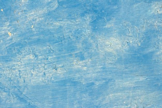 Tekstura tła copyspace niebieska farba z plamami i popping w niektórych miejscach