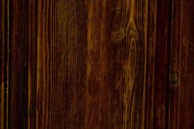 Tekstura tła naturalnego brązowego drewna z dekoracyjnym słojem drewna