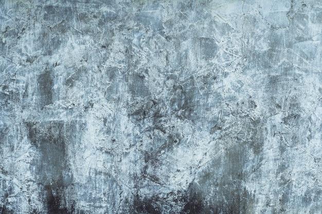 Tekstura tła. powierzchnia postarzanego betonu z pozostałościami białej farby. widok z góry. skopiuj miejsce