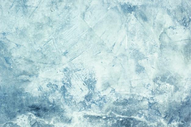 Tekstura tła tynku cementowego jest surowo niebieska.