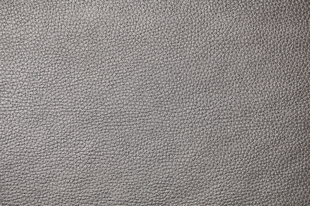 Tekstura tła z pełnej klatki fragmentu tkaniny meblowej, imitująca czarną skórę zwierzęcia.