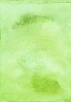 Tekstura tło akwarela zielony żółty. aquarelle jasne tło zielony limonkowy. malowane ręcznie