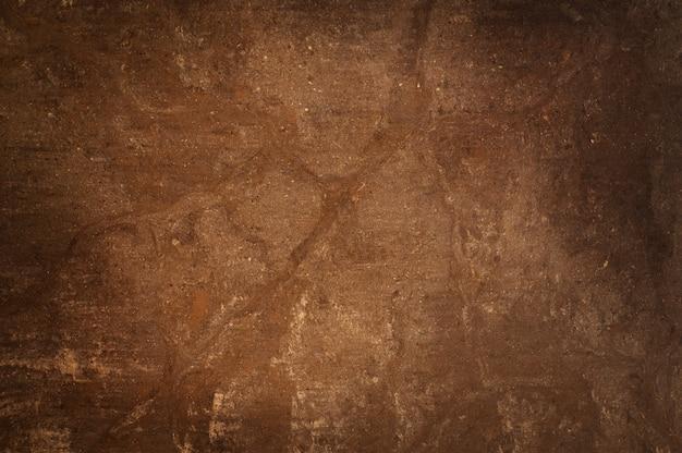 Tekstura tło brązowy kamień granit.