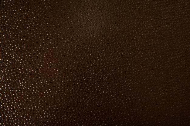 Tekstura tło brązowy papier do powierzchni. tekstura w tle z wypukłymi kulkami