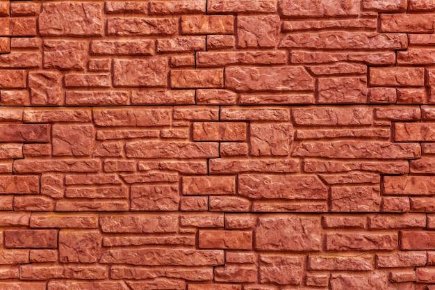 Tekstura tło czerwony, kamienny mur z cegły