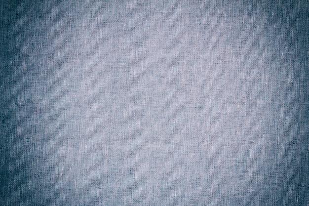 Tekstura tło jasnoniebieskiego płótna z winietą