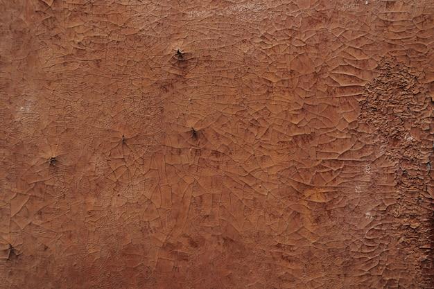 Tekstura tło. łuszcząca się i pękająca ściana