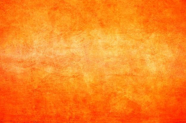 Tekstura tło pomarańczowe ściany betonowe.