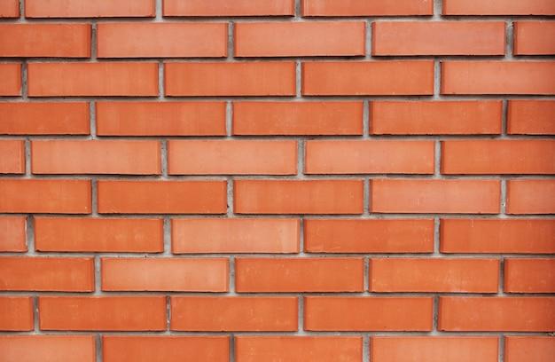 Tekstura tło ściany z czerwonej cegły, projektowanie zewnętrzne lub wewnętrzne