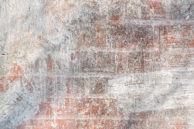 Tekstura tło starego ceglanego muru z białą farbą do makiety lub wzorca projektowego w układzie próbki wzorca budowlanego, spożywczego lub przemysłowego płaskiej warstwy