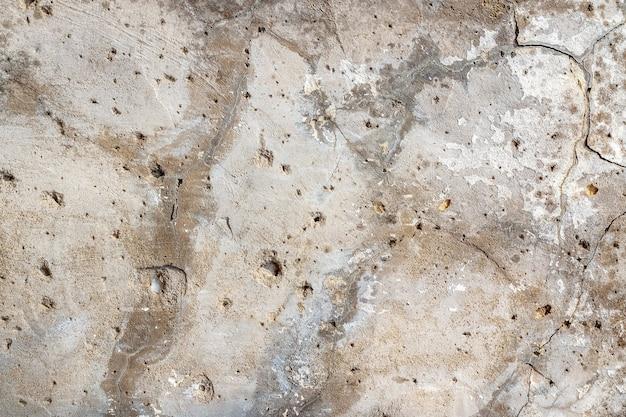 Tekstura tło starej betonowej ściany z pęknięciami dla makiety lub wzoru w budownictwie, żywności lub przemysłowej płaskiej warstwie przykładowego układu koncepcji.