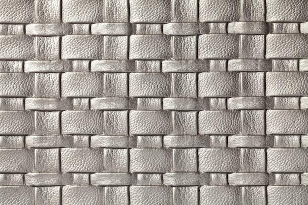 Tekstura tło szare i srebrne skórzane wzorkiem wikliny, makro