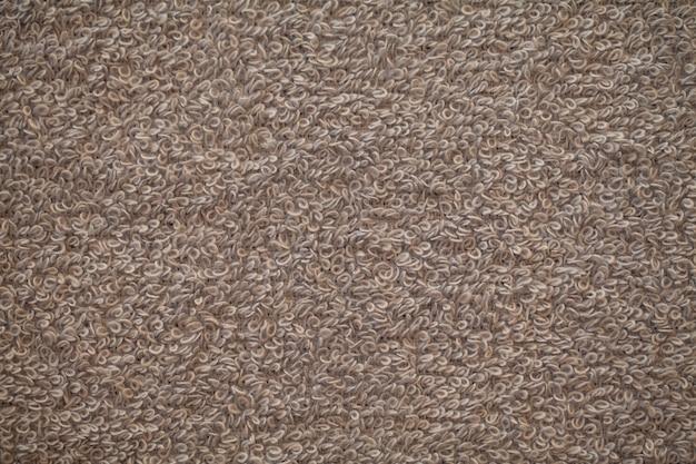 Tekstura tło szary ręcznik frotte naturalnej bawełny.