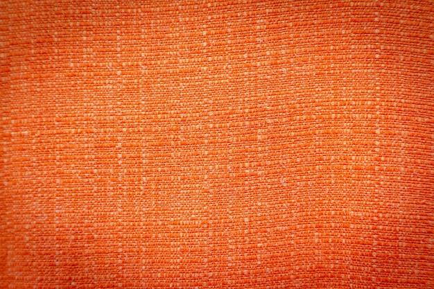 Tekstura tło tkaniny pomarańczowy tkaniny dla projektu